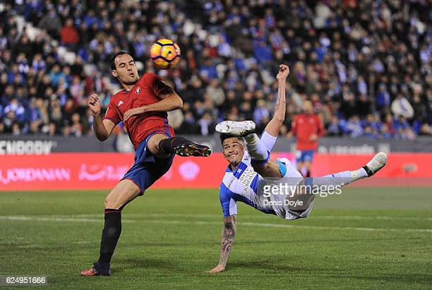 Luciano da Rocha Neves of CD Leganes shoots past Unai Garcia of CA Osasuna during the La Liga match between CD Leganes and CA Osasuna at Estadio...