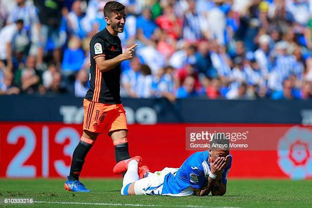 Luciano da Rocha of Deportivo Leganes reacts defeated as Jose Gaya of Valencia CF celebrates behind him during the La Liga match between CD Leganes...