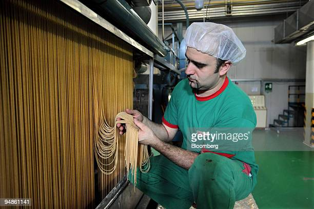 Luciano D'Alessandro a worker checks a batch of wholemeal spaghetti at the Delverde pasta factory in Fara San Martino Italy on Wednesday April 9 2008...