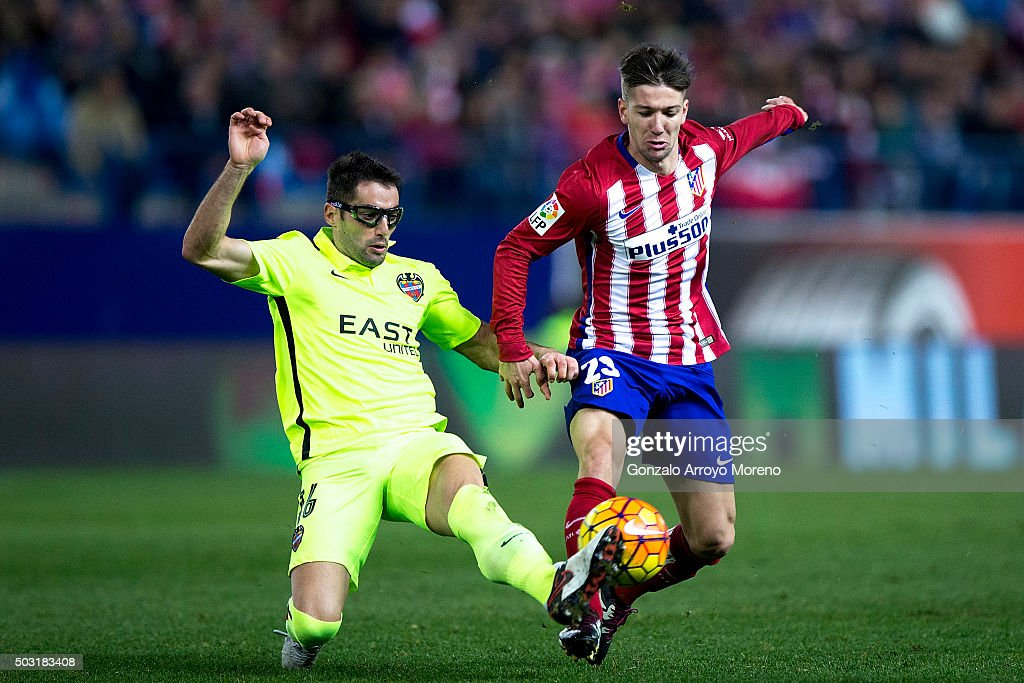Luciano Dario Vietto (R) of Atletico de Madrid Angel Trujillo (L) of Levante UD during the La Liga match between Club Atletico de Madrid and Levante UD at Vicente Calderon Stadium on January 2, 2016 in Madrid, Spain.