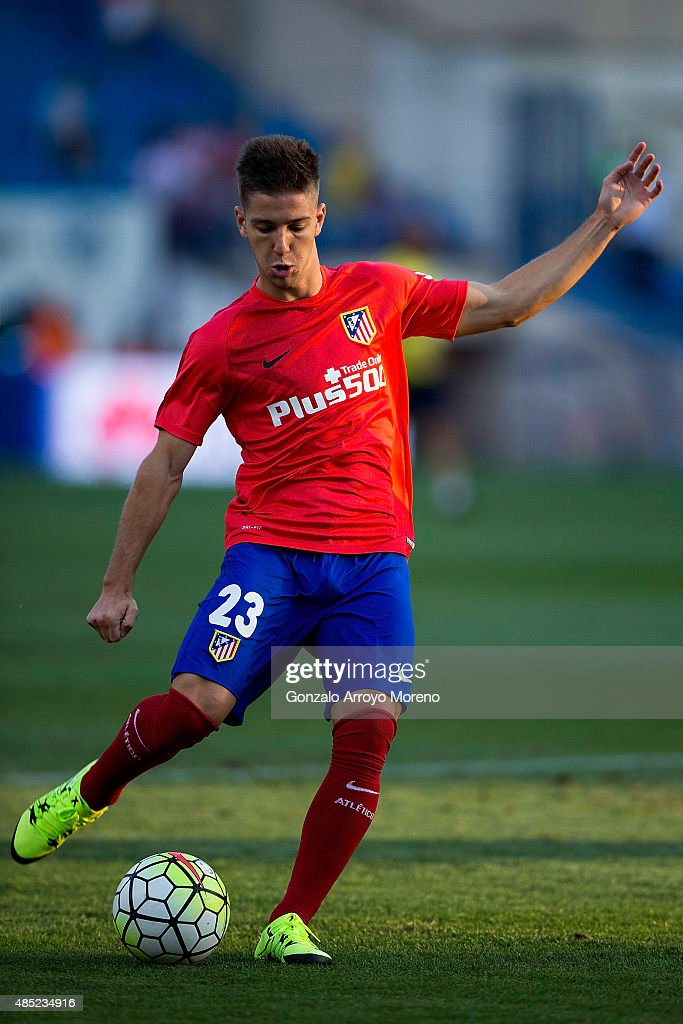 Luciano Dario Vietto of Atletico de Madrid controls the ball during his warming up before the La Liga match between Club Atletico de Madrid and UD Las Palmas at Vicente Calderon Stadium on August 22, 2015 in Madrid, Spain.