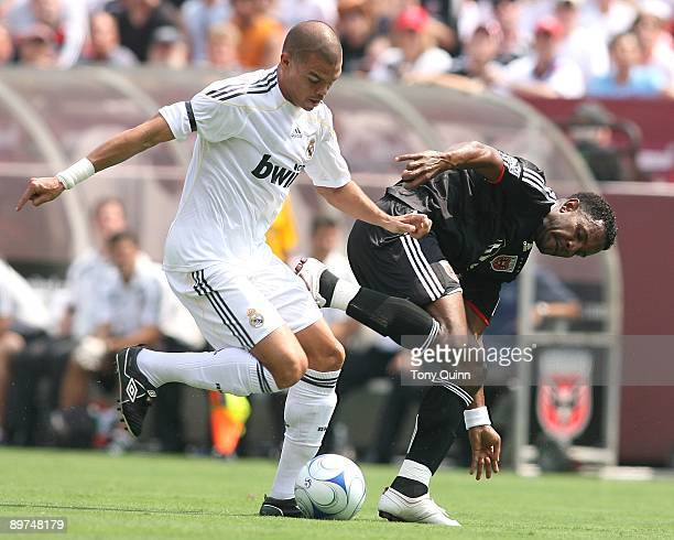 Luciano Emilio of DC United stumbles and loses the ball to Pepe of Real Madrid during an international friendly match at Fedex Field on August 9 2009...