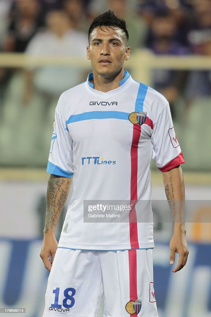 Luciano Fabian Monzon of Calcio Catania in action during the Serie A match between ACF Fiorentina and Calcio Catania at Stadio Artemio Franchi on August 26, 2013 in Florence, Italy.