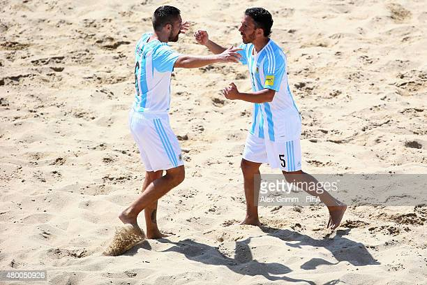 Luciano Franceschini of Argentina celebrates his team's second goal with team mate Rodrigo Lopez during the FIFA Beach Soccer World Cup Portugal 2015...