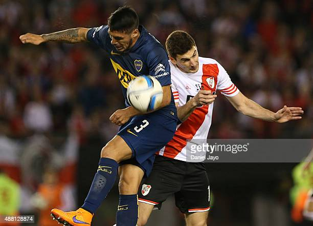 Luciano Monzon of Boca Juniors and Lucas Alario of River Plate go for a header during a match between River Plate and Boca Juniors as part of 24th...