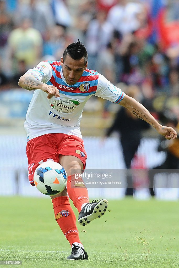 <a gi-track='captionPersonalityLinkClicked' href=/galleries/search?phrase=Luciano+Monzon&family=editorial&specificpeople=5043651 ng-click='$event.stopPropagation()'>Luciano Monzon</a> #18 of Calcio Catania in action during the Serie A match between Bologna FC and Calcio Catania at Stadio Renato Dall'Ara on May 11, 2014 in Bologna, Italy.