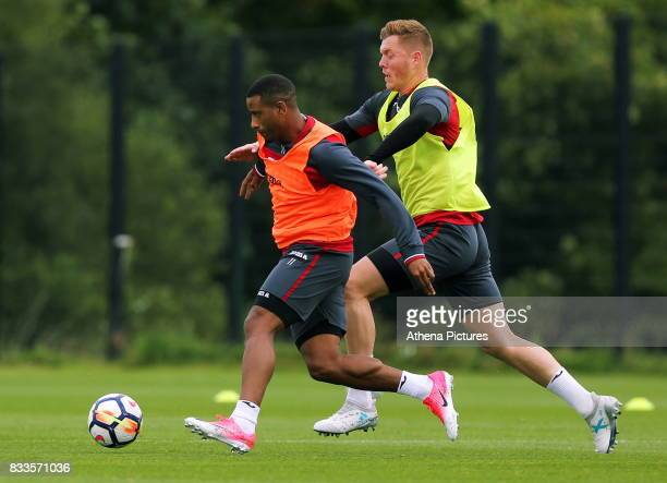 Luciano Narsingh chased by Alfie Mawson during the Swansea City Training at The Fairwood Training Ground on August 16 2017 in Swansea Wales