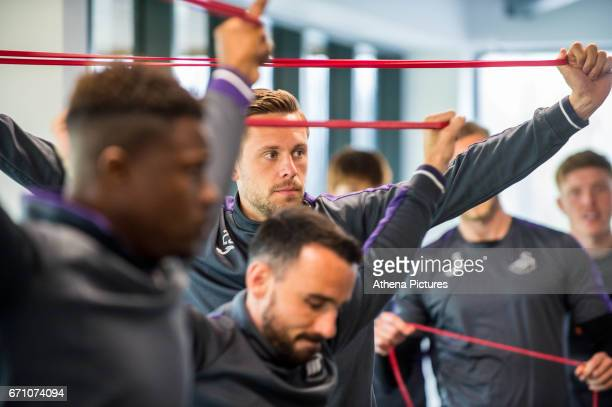 Luciano Narsingh Gylfi Sigurdsson and Leon Britton work out in the gymnasium during the Swansea City Training at The Fairwood Training Ground on...