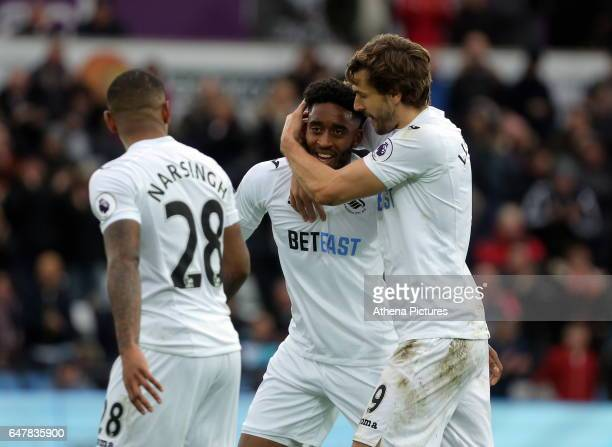 Luciano Narsingh Leroy Fer and Fernando Llorente of Swansea City celebrate the first goal scored by Llorente during the Premier League match between...