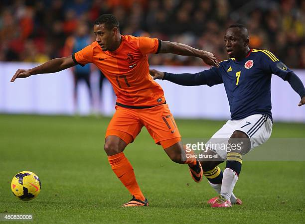Luciano Narsingh of Netherlands in action with Pablo Armero of Colombia during the friendly International match between the Netherlands and Colombia...