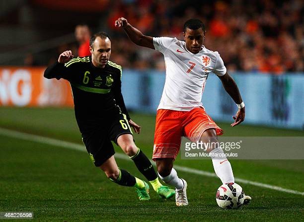 Luciano Narsingh of Netherlands is closed down by Andres Iniesta of Spain during the international friendly match between the Netherlands and Spain...