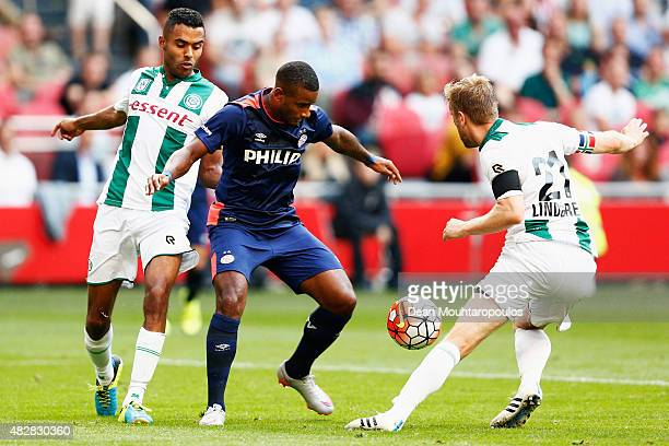 Luciano Narsingh of PSV battles for the ball with Abel Tamata and Rasmus Lindgren of Groningen during the Johan Cruijff Shield match between FC...