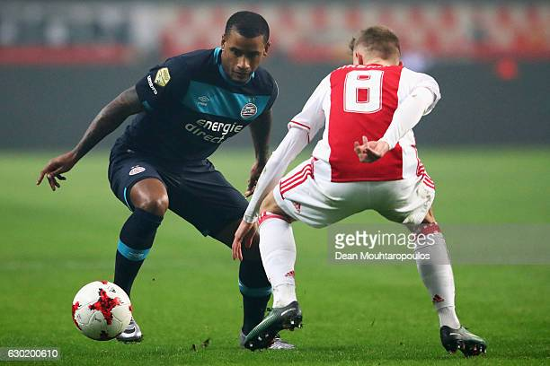 Luciano Narsingh of PSV battles for the ball with Daley Sinkgraven of Ajax during the Eredivisie match between Ajax Amsterdam and PSV Eindhoven held...