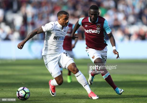 Luciano Narsingh of Swansea City and Arthur Masuaku of West Ham United battle for possession during the Premier League match between West Ham United...