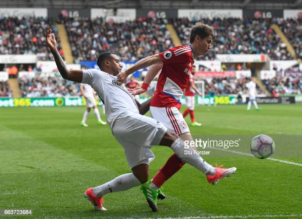 Luciano Narsingh of Swansea City and Marten de Roon of Middlesbrough battle for possession during the Premier League match between Swansea City and...