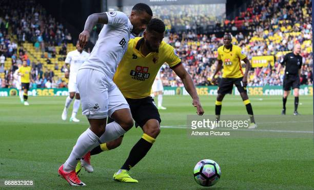 Luciano Narsingh of Swansea City is challenged by Adrian Mariappa of Watford the Premier League match between Watford and Swansea City at Vicarage...