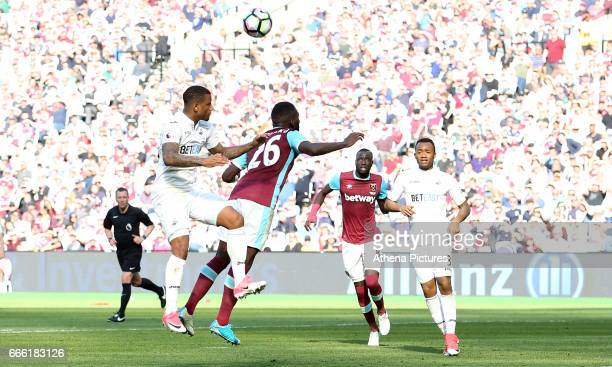 Luciano Narsingh of Swansea City is challenged by Arthur Masuaku of West Ham United during the Premier League match between West Ham United and...