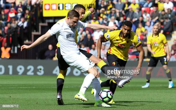 Luciano Narsingh of Swansea City is challenged by Etienne Capoue of Watford during the Premier League match between Watford and Swansea City at...