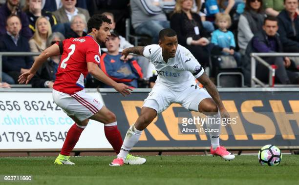 Luciano Narsingh of Swansea City is closely marked by Fábio of Middlesbrough during the Premier League match between Swansea City and Middlesbrough...
