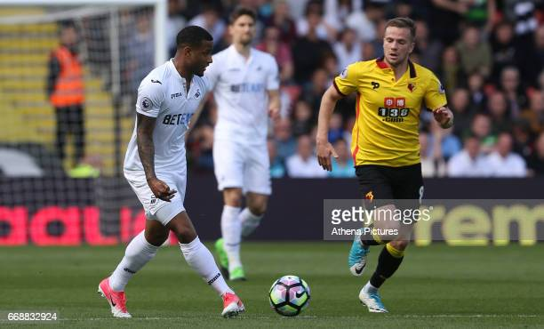 Luciano Narsingh of Swansea City is closely marked by Tom Cleverley of Watford during the Premier League match between Watford and Swansea City at...