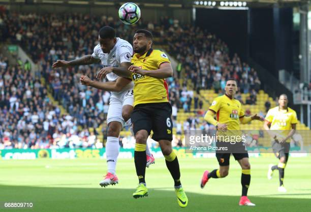 Luciano Narsingh of Swansea Citycontends with Adrian Mariappa of Watford for the aerial ball during the Premier League match between Watford and...