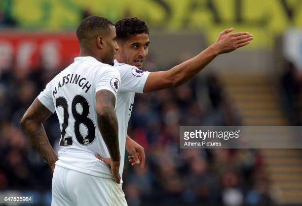 Luciano Narsingh speaks with team mate Kyle Naughton of Swansea City during the Premier League match between Swansea City and Burnley at The Liberty...