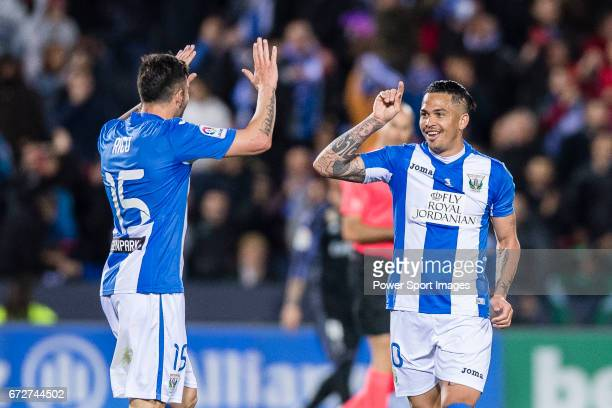 Luciano Neves of Deportivo Leganes celebrates with teammate Diego Rico during their La Liga match between Deportivo Leganes and Real Madrid at the...