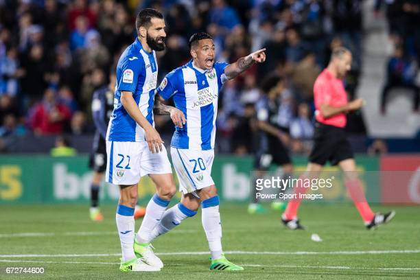 Luciano Neves of Deportivo Leganes celebrates with teammate Lluis Sastre Reus during their La Liga match between Deportivo Leganes and Real Madrid at...