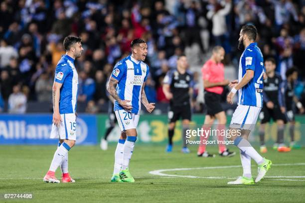 Luciano Neves of Deportivo Leganes celebrates with teammates Diego Rico and Lluis Sastre Reus during their La Liga match between Deportivo Leganes...