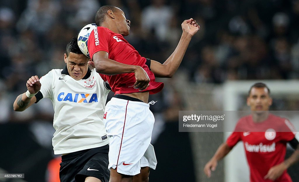 Luciano of Corinthians fights for the ball with Fabricio of Internacional during the match between Corinthians and Internacional for the Brazilian Series A 2014 at Arena Corinthians on July 17, 2014 in Sao Paulo, Brazil.