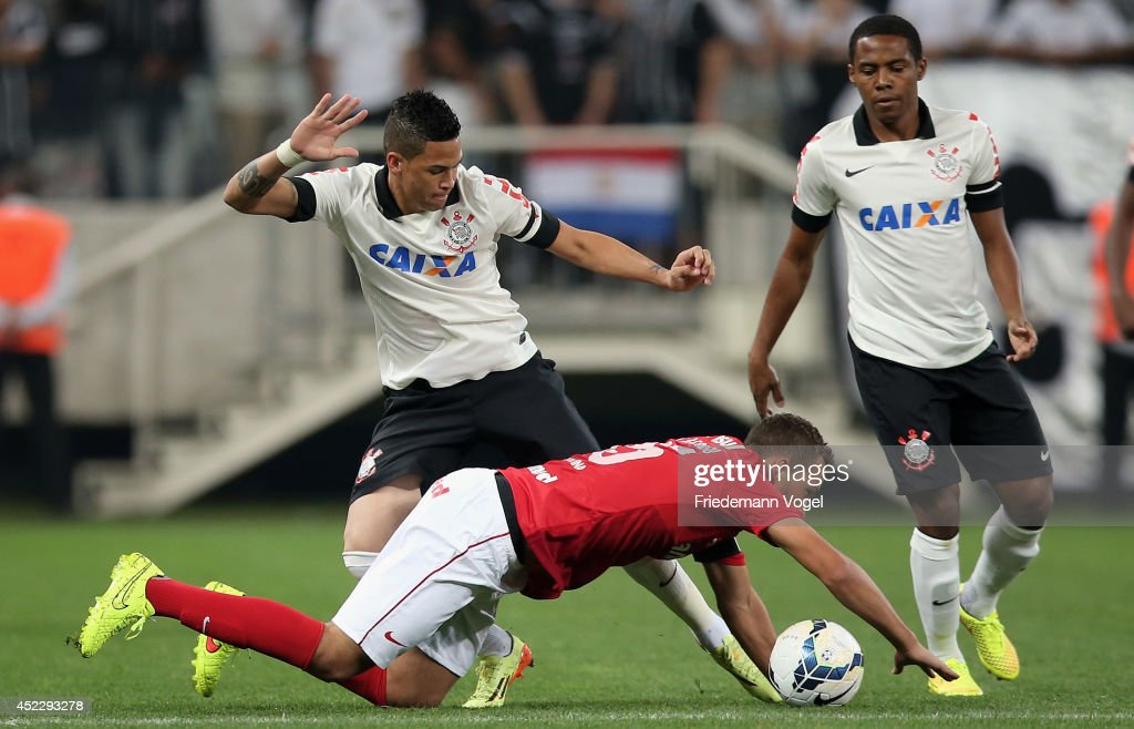 Luciano of Corinthians fights for the ball with Joao Afonso of Internacional during the match between Corinthians and Internacional for the Brazilian Series A 2014 at Arena Corinthians on July 17, 2014 in Sao Paulo, Brazil.