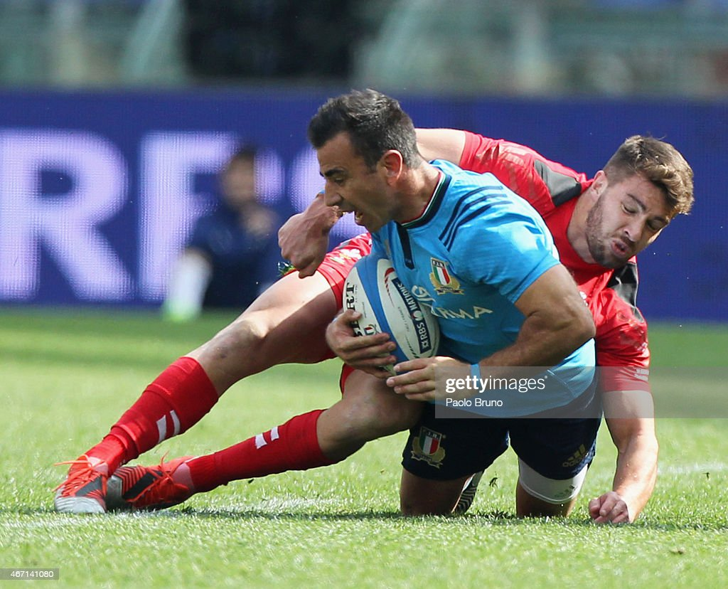<a gi-track='captionPersonalityLinkClicked' href=/galleries/search?phrase=Luciano+Orquera&family=editorial&specificpeople=236091 ng-click='$event.stopPropagation()'>Luciano Orquera</a> of Italy is tackled by <a gi-track='captionPersonalityLinkClicked' href=/galleries/search?phrase=Rhys+Webb+-+Rugby+Player&family=editorial&specificpeople=8778685 ng-click='$event.stopPropagation()'>Rhys Webb</a> of Wales during the RBS Six Nations match between Italy and Wales at Stadio Olimpico on March 21, 2015 in Rome, Italy.