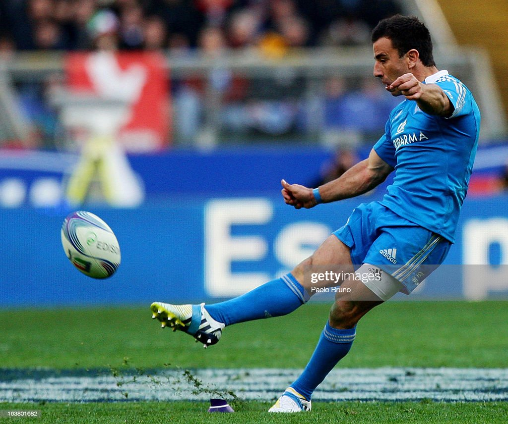 <a gi-track='captionPersonalityLinkClicked' href=/galleries/search?phrase=Luciano+Orquera&family=editorial&specificpeople=236091 ng-click='$event.stopPropagation()'>Luciano Orquera</a> of Italy kicks to score during the RBS Six Nations match between Italy and Ireland at Stadio Olimpico on March 16, 2013 in Rome, Italy.