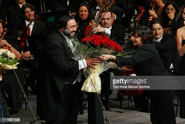 Luciano Pavarotti receiving red roses for his birthday from Denise Fabre