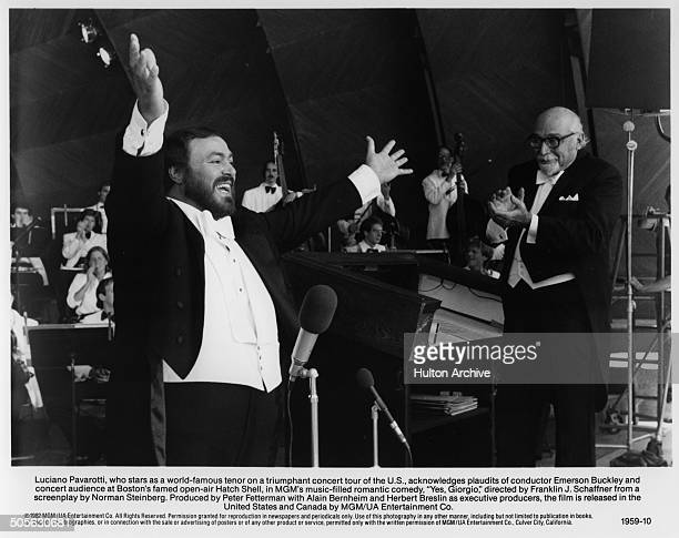 Luciano Pavarotti sings at the Hatch Shell concert hall as conductor Emerson Buckley leads the orchestra n a scene from the movie 'Yes Giorgio' circa...