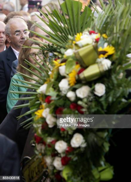 Luciano Pavarott's wife Nicoletta Mantovani follows his casket outside the 12th century cathedral Duomo Di Modena in Italy where his the funeral took...