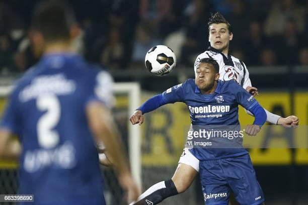 Luciano Slagveer of Heerenveen Justin Hoogma of Heracles Almeloduring the Dutch Eredivisie match between Heracles Almelo and sc Heerenveen at Polman...