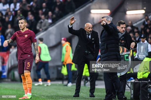 Luciano Spalletti coach of As Roma and Leandro Paredes during the Uefa Europa League Round of 16 first leg match between Olympique Lyonnais Lyon and...
