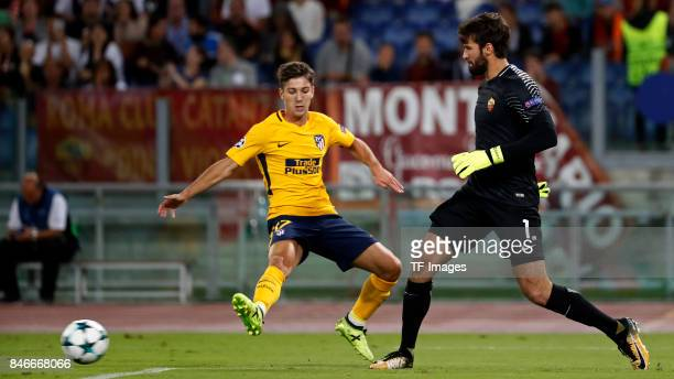 Luciano Vietto of Atletico Madrid and Alisson of Rom battle for the ball during the UEFA Champions League group C match between AS Roma and Atletico...