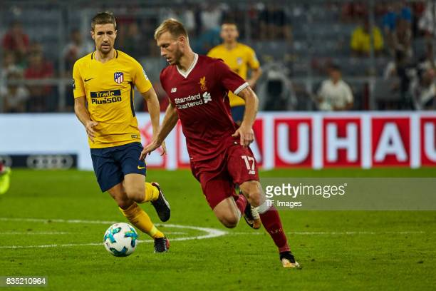 Luciano Vietto of Atletico Madrid and Ragnar Klavan of Liverpool battle for the ball during the Audi Cup 2017 match between Liverpool FC and Atletico...