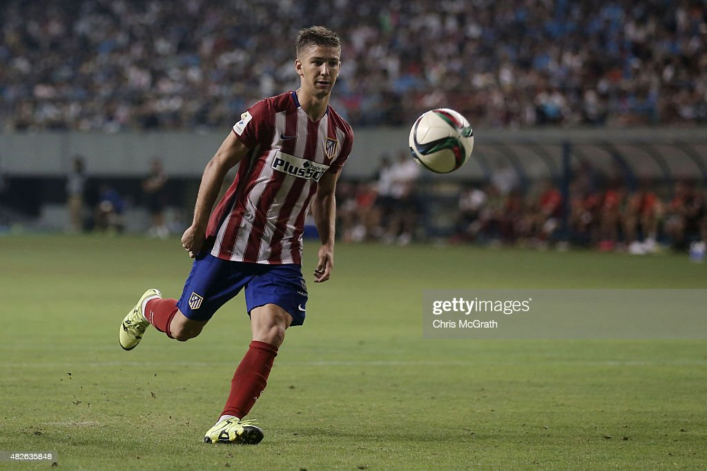 <a gi-track='captionPersonalityLinkClicked' href=/galleries/search?phrase=Luciano+Vietto&family=editorial&specificpeople=9755198 ng-click='$event.stopPropagation()'>Luciano Vietto</a> #23 of Atletico Madrid kicks the winning goal during a penalty shoot out against Sagan Tosu F.C. during the friendly match between Atletico Madrid and Sagan Tosu F.C. at Tosu Stadium on August 1, 2015 in Tosu, Japan.