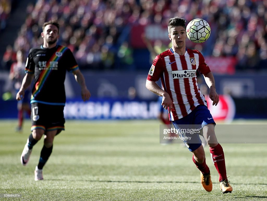 Luciano Vietto (R) of Atletico Madrid vies with Quini (L) of Rayo Vallecano during the La Liga football match between Atletico Madrid and Rayo Vallecano at Vicente Calderon, in Madrid, Spain on April 30, 2016.