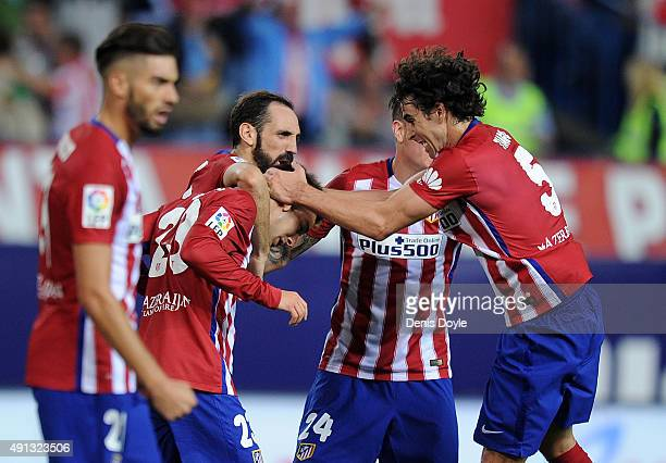 Luciano Vietto of Club Atletico de Madrid celebrates with Tiago Mendes after scoring Atletico's opening goal during the La Liga match between Club...