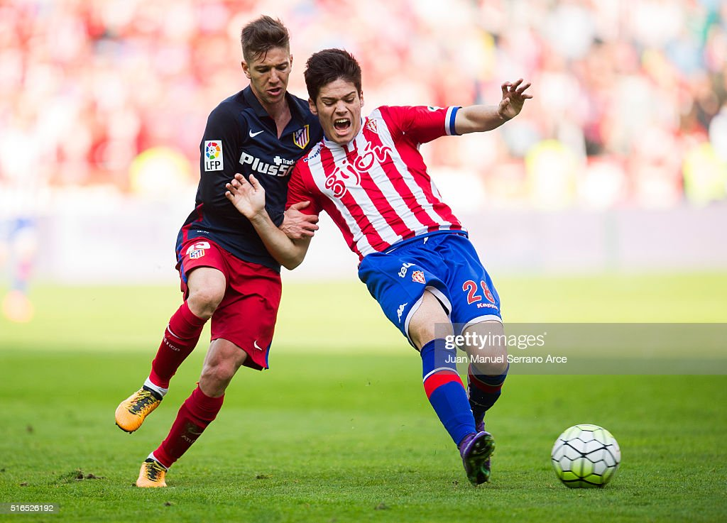 <a gi-track='captionPersonalityLinkClicked' href=/galleries/search?phrase=Luciano+Vietto&family=editorial&specificpeople=9755198 ng-click='$event.stopPropagation()'>Luciano Vietto</a> of Club Atletico de Madrid duels for the ball with Jorge Mere of Real Sporting de Gijon during the La Liga match between Real Sporting de Gijon and Club Atletico de Madrid at Estadio El Molinon on March 19, 2016 in Gijon, Spain.