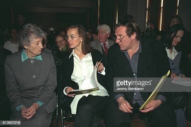 Lucie Aubrac with actors Gerard Depardieu and Carole Bouquet who both recited poetry