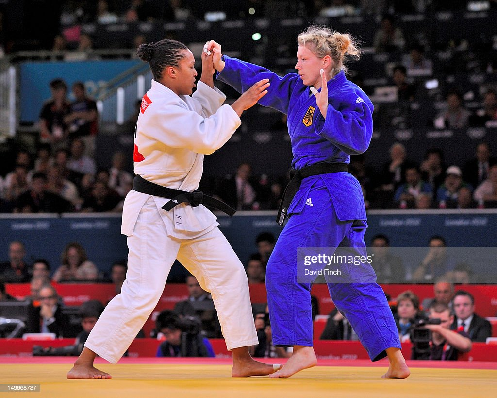 Lucie Decosse of France (white) defeats Kirsten Thiele of Germany for the gold medal in the Women's -70 kg Judo final at the ExCeL Centre, on August 01, 2012 in London, England.