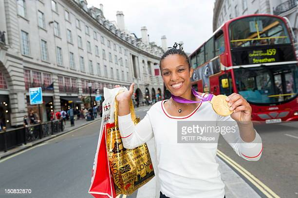 Lucie Decosse winner of the gold medal in judo during the Summer Olympics 2012 poses in the city of London with her medal on August 4 2012 in London...