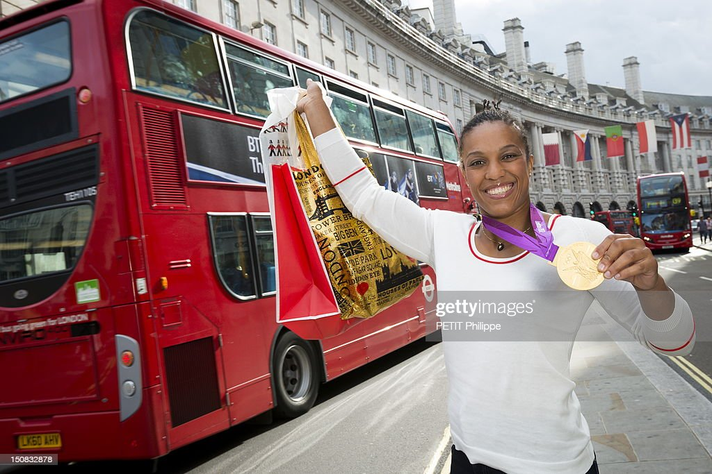 Lucie Decosse winner of the gold medal in judo during the Summer Olympics 2012 poses in the city of London with her medal on August 4, 2012 in London, England.