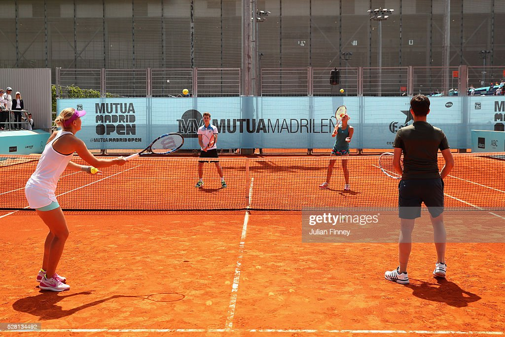 <a gi-track='captionPersonalityLinkClicked' href=/galleries/search?phrase=Lucie+Hradecka&family=editorial&specificpeople=4882302 ng-click='$event.stopPropagation()'>Lucie Hradecka</a> and Andrea Hlavackova of Czech Republic meet and play with two local teenagers during day five of the Mutua Madrid Open tennis tournament at the Caja Magica on May 04, 2016 in Madrid, Spain.