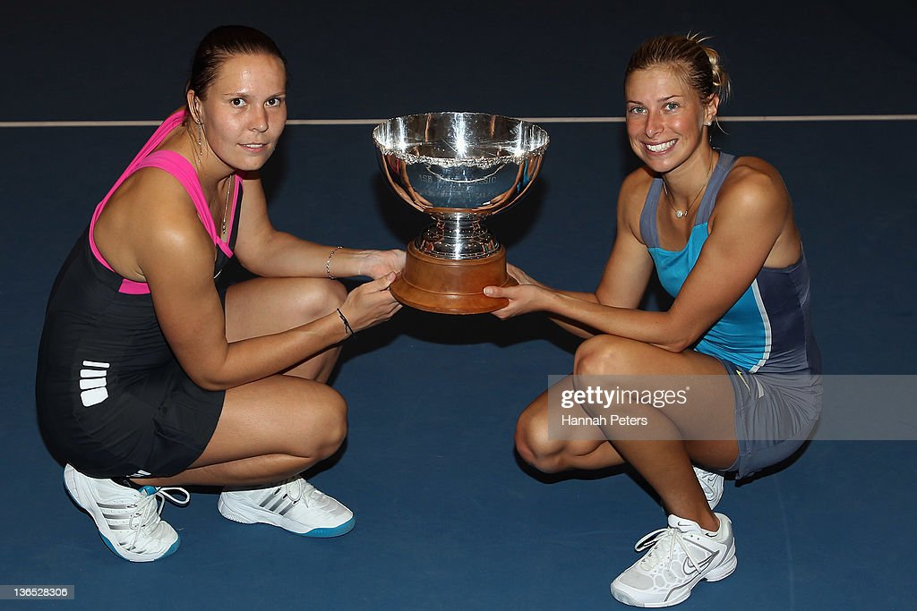 <a gi-track='captionPersonalityLinkClicked' href=/galleries/search?phrase=Lucie+Hradecka&family=editorial&specificpeople=4882302 ng-click='$event.stopPropagation()'>Lucie Hradecka</a> and <a gi-track='captionPersonalityLinkClicked' href=/galleries/search?phrase=Andrea+Hlavackova&family=editorial&specificpeople=3378910 ng-click='$event.stopPropagation()'>Andrea Hlavackova</a> of the Czech Republic hold the trophy up after beating Flavia Pennetta of Italy and Julia Goerges of Germany in the Women's Final match during day six of the 2012 ASB Classic at ASB Tennis Centre on January 7, 2012 in Auckland, New Zealand.